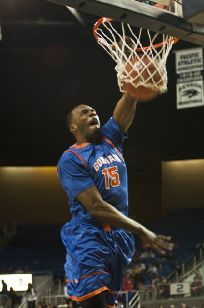 Bishop Gorman High's Shabazz Muhammad soars to the hoop for an uncontested dunk during the Gaels' 96-51 win over Northern Nevada's Hug High in the state championship game at Lawlor Events Center in Reno.