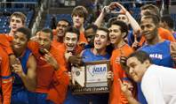 Bishop Gorman players gather around the 4A state championship trophy after defeating Northern Nevada's Hug High 96-51 at Lawlor Events Center in Reno.