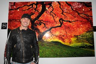 Peter Lik at the grand opening of Lik Gallery at Mandalay Place on Saturday, Feb. 25, 2012. Lik is pictured here with his