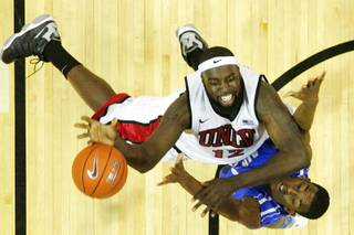 UNLV forward Brice Massamba shoots over Air Force forward Justin Hammonds during their game Saturday, Feb. 25, 2012. UNLV won the game 68-58.