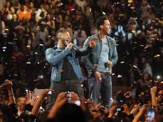Romeo Santos, right, performs with Usher during a concert at Madison Square Garden, Friday, Feb. 24, 2012 in New York.