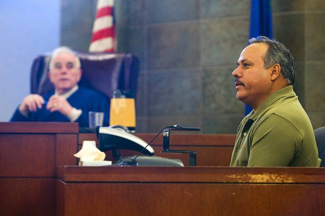 Judge William Jansen listens as security officer Oscar Velasquez testifies during a preliminary hearing in District Court Tuesday Feb. 28, 2012. Benjamin Gerard Hawkins, a Gainesville, Fla., teacher who was on vacation, is facing charges of involuntary manslaughter in connection with the death of another tourist after an altercation at O'Sheas in July.