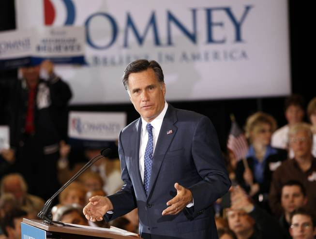 Mitt Romney speaks to supporters at his election watch party Tuesday after winning the Michigan primary in Novi, Mich.