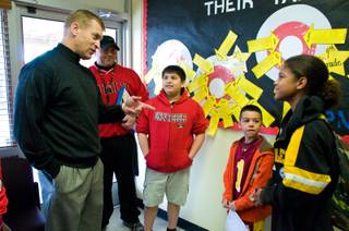 UNLV football coach Bobby Hauck talks with students at Crestwood Elementary School, Wednesday Feb. 29, 2012.