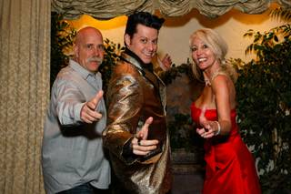 John Walker, 52, and Debbie Dieterich, 48, strike a pose with Elvis after he married them on Wednesday, February 29, 2012, at the Viva Las Vegas Wedding Chapel on The Vegas Strip.
