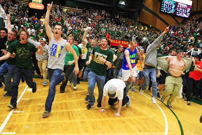 Colorado State fans rush the court after upsetting UNLV 66-59 Wednesday, Feb. 29, 2012 at Moby Arena in Ft. Collins.