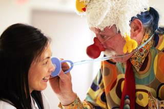Dr. Patch Adams clowns with pediatric nurse practitioner Nikki Cuasay at the Children's Medical Center at Summerlin Hospital in Las Vegas on Thursday, March 1, 2012.
