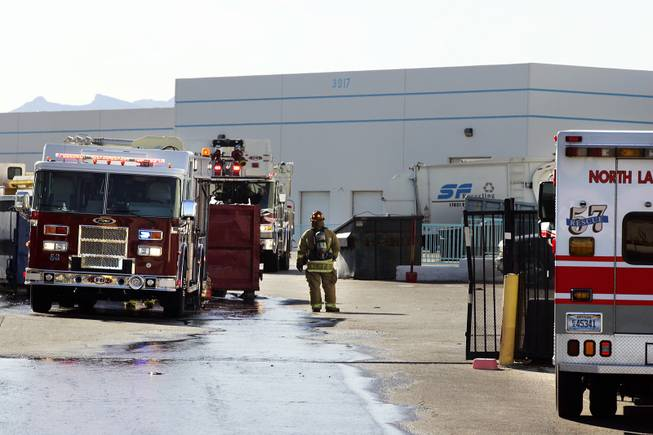 Firefighters with the North Las Vegas Fire Department on the scene of a fire at Secured Fibres, a recycling plant in North Las Vegas on Friday, March 2, 2012.