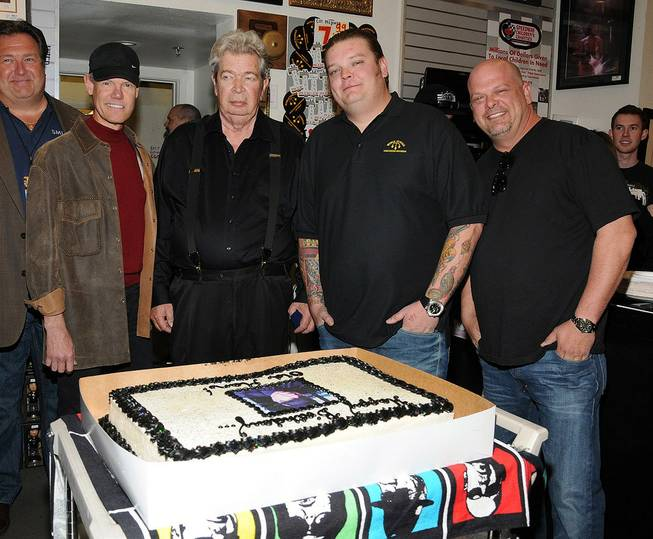 "Richard ""The Old Man"" Harrison of ""Pawn Stars"" celebrates his 71st birthday at Gold & Silver Pawn, with special guest Randy Travis, on Friday, March 2, 2012. Harrison's grandson Corey and son Rick also are pictured here."