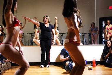 Denise Dinger holds posing practice with Dee's Divas at Yak's Fitness in Las Vegas on Saturday, March 3, 2012.