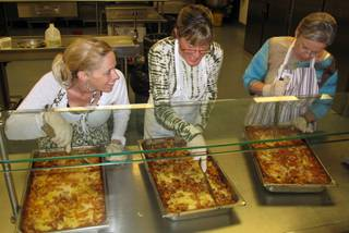 Volunteers prepare lasagna for residents of the Las Vegas Rescue Mission and the homeless for their monthly