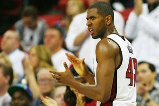 UNLV forward Mike Moser celebrates a call during the first half of their game against Wyoming Saturday, March 3, 2012 at the Thomas & Mack Center.