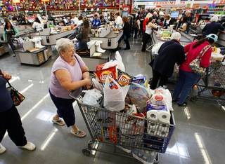 A woman leaves with her purchases during the grand opening a WinCo Foods supermarket at Stephanie Street and Wigwam Parkway in Henderson Sunday, March 4, 2012. The Boise-based supermarket chain opened their 81st and 82nd stores Sunday, their first stores in Southern Nevada.