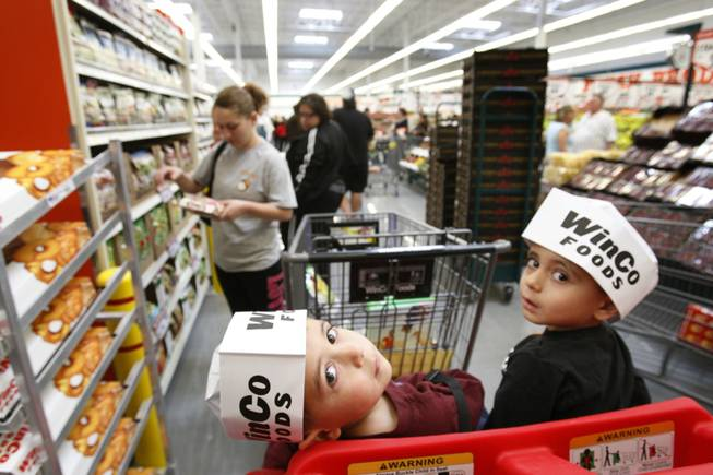 Three-year-old twins Armann, left, and Aryan Saadi wear Winco hats as their mother shops during the grand opening a WinCo Foods supermarket at Stephanie Street and Wigwam Parkway in Henderson Sunday, March 4, 2012. The Boise-based supermarket chain opened their 81st and 82nd stores Sunday, their first stores in Southern Nevada. STEVE MARCUS