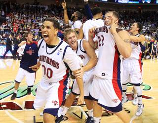 Saint Mary's Gaels' Brad Waldow (L) and teammates celebrate after beating the Gonzaga Bulldogs in 78-74 in overtime during the NCAA West Coast Conference Basketball Championship final in Las Vegas, Nevada March 5, 2012.