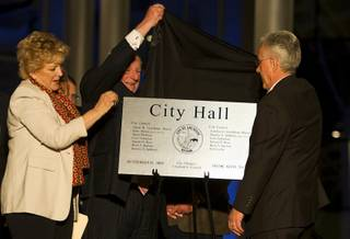 Las Vegas Mayor Carolyn Goodman, former Mayor Oscar Goodman and former City Councilman Gary Reese unveil a building dedication plaque during the dedication of the new city hall in downtown Las Vegas Monday, March 5, 2012.