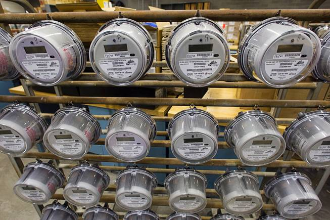 Smart meters hang on a rack at the NV Energy meter shop Tuesday, March 6, 2012. NV Energy plans to install 1.3 million smart meters as part of an electrical grid modernization.