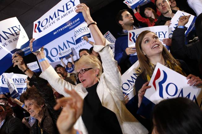 Supporters cheer as election results come in at the Super Tuesday primary watch party for Republican presidential candidate Mitt Romney in Bosto on March 6, 2012.