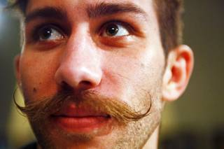Chase Hackett of Littleton, Co. shows off his mustache during a press conference to announce the cast of UFC's