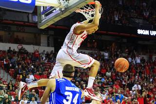 New Mexico guard Kendall Williams hangs on the rim after a dunk against Air Force during their Mountain West Conference Tournament game Thursday, March 8, 2012.  Williams incurred a technical foul for hanging on the rim.