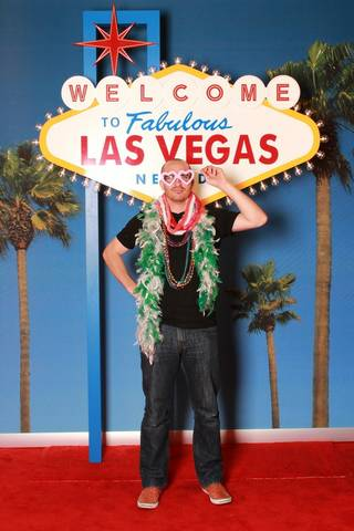 Confess Media's collection of photos take under replica of the Las Vegas Welcome Sign, set up near the baggage claim at McCarran International Airport, March 9, 2012.