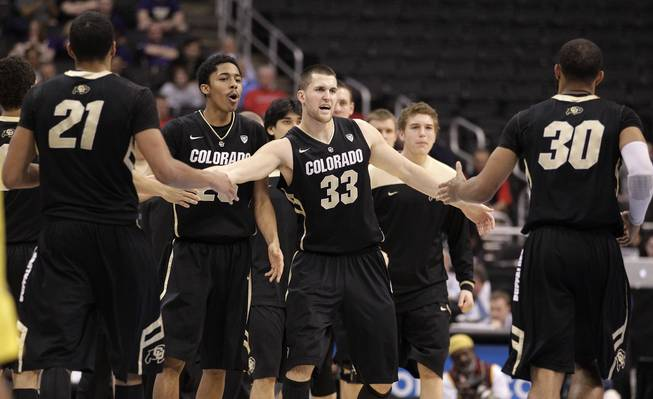 Colorado's Andre Roberson, left, and Colorado's Carlon Brown, right, are greeted by teammates during the second half of an NCAA college basketball game against the Oregon at the Pac-12 conference championship in Los Angeles, Thursday, March 8, 2012.