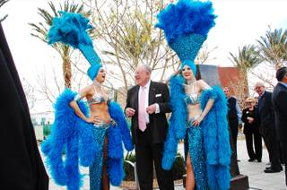 Former Las Vegas Mayor Oscar Goodman, accompanied by his famous showgirls, awaits the unveiling of a bronze bust in his likeness at Symphony Park, Monday March, 12 2012.