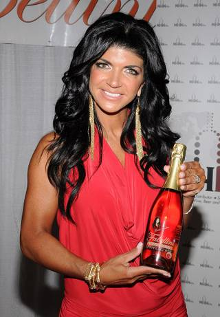 Teresa Giudice holding her Fabellini wine at Day 1 of the 2012 Nightclub and Bar Convention on Tuesday, March 13, 2012.