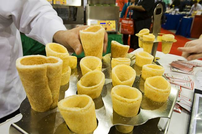 Edible pizza cones are displayed at the Conocopia booth during the International Pizza Expo at the Las Vegas Convention Center Wednesday, March 14, 2012. The cones can be filled with pizza fixings or a variety of other fillings.