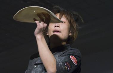 Kazuya Akaogi, 30, of Japan competes in the acrobatic portion of the World Pizza Games, part of the International Pizza Expo, at the Las Vegas Convention Center Wednesday, March 14, 2012.