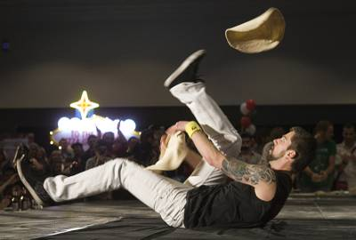 Jay Schuurman, 26, of Sacramento, Calif. competes in the masters acrobatic portion of the World Pizza Games, part of the International Pizza Expo, at the Las Vegas Convention Center Wednesday, March 14, 2012. Schuurman took first place in the masters division.