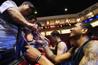 Anthony Marshall signs autographs after practice before their second round NCAA Men's Basketball Championship game Wednesday, March 14, 2012 at The Pit in Albuquerque. The Runnin' Rebels will take on Pac 12 champions Colorado on Thursday.