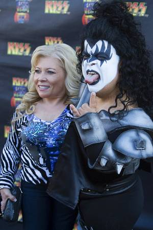 "Kiss by Monster Mini Gold spokesman Brian ""Lowercase g"" Thomas and ""Lowercase s"" arrive on the black carpet during the grand opening of Kiss by Monster Mini Golf at 4503 Paradise Road Thursday, March 15, 2012."