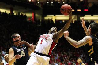 UNLV forward Quintrell Thomas grabs his own rebound against Colorado during their second round NCAA Men's Basketball Championship game Thursday, March 15, 2012 at The Pit in Albuquerque.