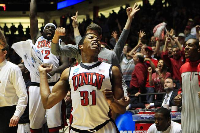 UNLV guard Justin Hawkins celebrates his three-point shot that brought the Rebels to within two points of Colorado during their second round NCAA Men's Basketball Championship game Thursday, March 15, 2012 in Albuquerque. It was the closest the Rebels got as UNLV lost the game 68-64.