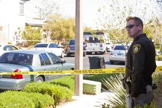 Police investigate the scene of a shooting where a Summerlin resident shot and killed an intruder in his backyard, Tuesday, March 20, 2012.
