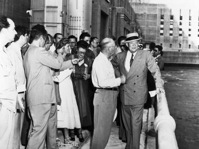 General Dwight D. Eisenhower on Nevada power house ramp talks with Director of Power L.R. Douglass. Hoover.