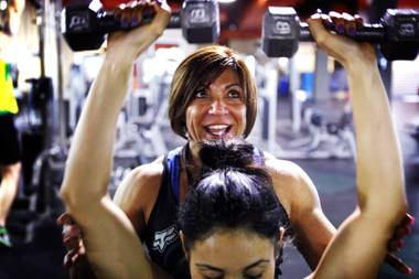 Denise Dinger trains one of her clients at City Athletic Club in Las Vegas on Tuesday, March 20, 2012.