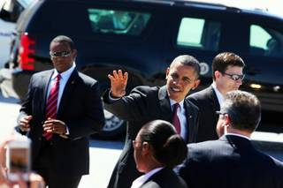President Barack Obama greets people after arriving at McCarran Airport in Las Vegas on Wednesday, March 21, 2012.