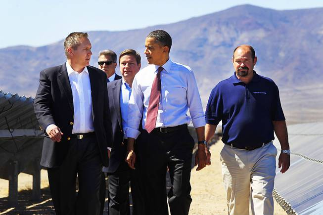 President Barack Obama walks with Sempra U.S. Gas & Power's, from left, CEO Jeff Martin, Vice President Operations John Sowers and Kevin Gillespie, right, while touring their Copper Mountain Solar 1 photovoltaic plant Wednesday, March 21, 2012 south of Boulder City.