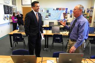 Governor Brian Sandoval speaks with Rancho High School aviation teacher Bob Hale Thursday, March 22, 2012 while looking at aviation education in Southern Nevada.