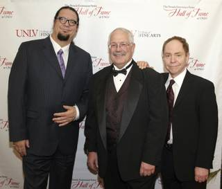 Nevada Entertainer/Artist Hall of Fame inductees Penn & Teller flank UNLV College of Fine Arts Dean Jeff Koep during the Ninth Annual Hall of Fame dinner at UNLV on Thursday, March 22, 2012.
