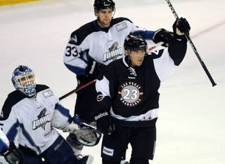Idaho players look on as Judd Blackwater (23) holds his stick up in celebration after scoring his 19th goal of the season during the first period of play against the Steelheads on Friday night, March 23, 2012, at the Orleans Arena.