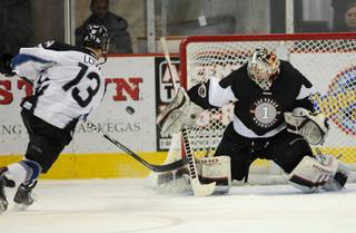 Wranglers goaltender Mitch O'Keefe foils a shootout attempt by Steelheads forward Ian Lowe on Saturday night as the two teams completed regulation time and an overtime period tied for the second night in a row at the Orleans Arena.