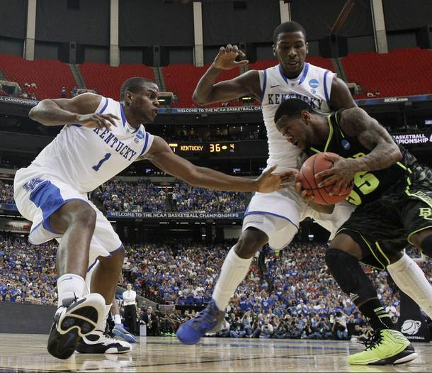 Baylor's Pierre Jackson (55) drives against Kentucky's Michael Kidd-Gilchrist, center, and Kentucky's Darius Miller during the first half of an NCAA tournament South Regional finals college basketball game Sunday, March 25, 2012, in Atlanta.