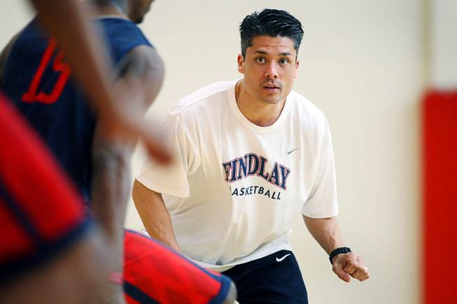 Findlay Prep head coach Michael Peck watches players during practice at the Henderson International School campus on Monday, March 26, 2012.