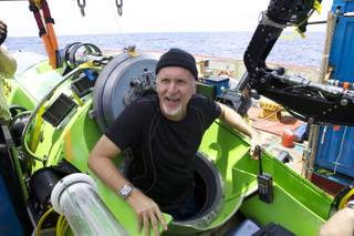 Filmmaker and National Geographic Explorer-in-Residence James Cameron emerges from the Deepsea Challenger submersible after his successful solo dive to the Mariana Trench, the deepest part of the ocean, Monday March 26, 2011. The dive was part of Deepsea Challenge, a joint scientific expedition by Cameron, the National Geographic Society and Rolex to conduct deep-ocean research.