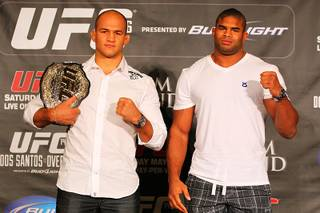 Junior Dos Santos, left, and Alistair Overeem pose for photos during a news conference Tuesday, March 27, 2012 to advance the all heavyweight card at UFC 146.
