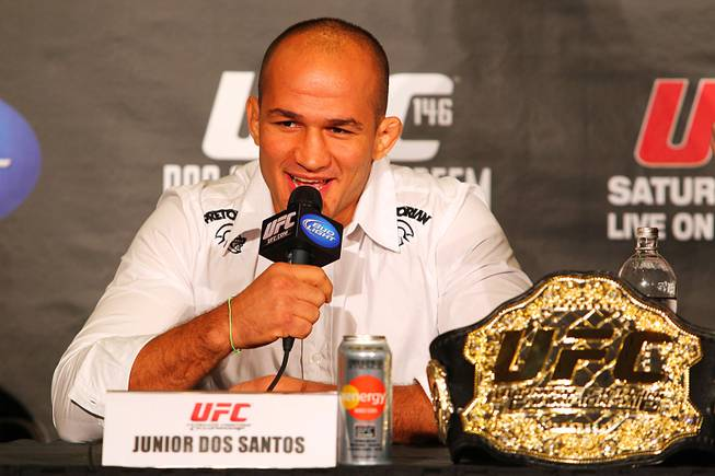 Champion Junior Dos Santos answers a question during a news conference Tuesday, March 27, 2012 to advance the all heavyweight card at UFC 146.