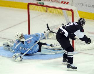 Wranglers forward Eric Lampe roofs a goal over the outstretched glove of Alaska goaltender Gerald Coleman for his 36th goal of the season on Tuesday night, March 27, 2012, at the Orleans Arena. With the goal, Lampe tied the Wranglers' single-season goal scoring record held by Peter Ferarro.